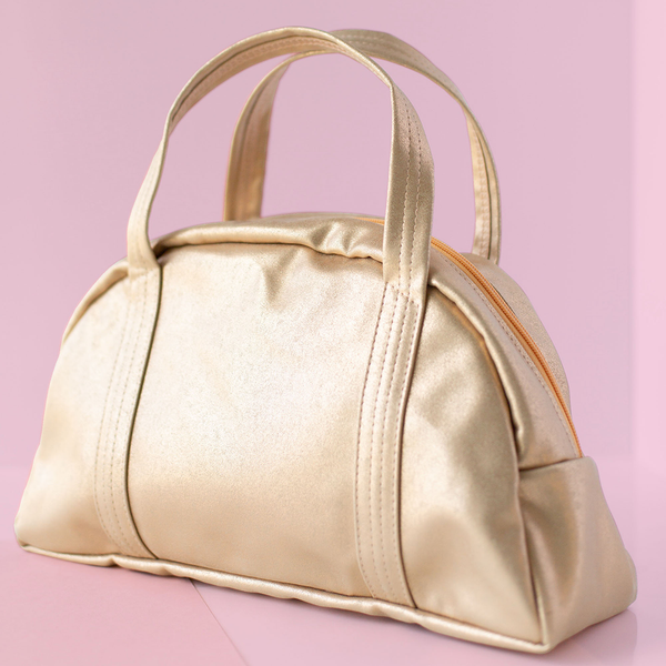 Cute handbag in gold metallic vegan leather and a zippered top.