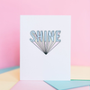 White greeting card standing open with 3d text