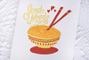 White greeting card with a bowl of noodles and chop sticks. The text says