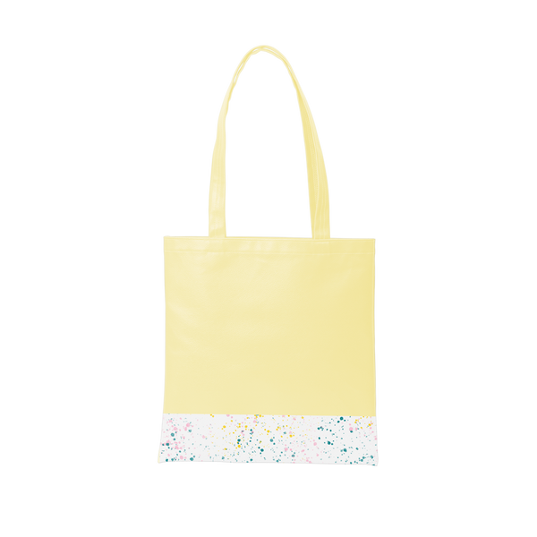 Yellow tote bag with a long shoulder strap and white paint splatter detail along the bottom.