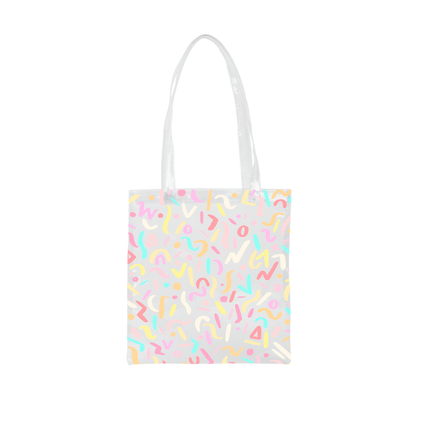 Cute clear tote bag in vinyl with rainbow confetti pattern.