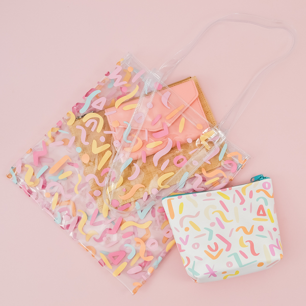 Party Animal Tweedle Dee is a cute cosmetics bag with rainbow confetti pattern and blue zipper.