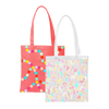 Two cute tote bags; one clear vinyl with rainbow confetti and the other red with rainbow polka dots.