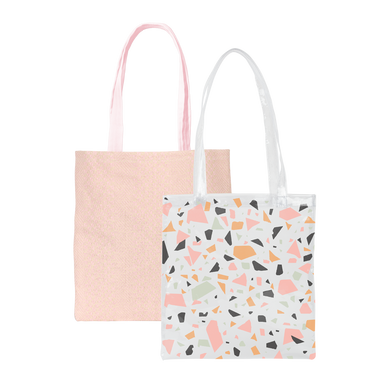 Two cute tote bags in pink straw and a clear vinyl with terazzo pattern.