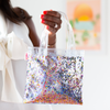 Tiny handbag in clear vinyl with rainbow glitter confetti.