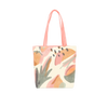Cute tote bag with abstract fruit design and peach shoulder straps.