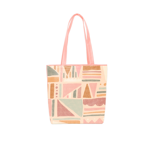 Cute tote bag with geometric fruit design and peach shoulder straps.