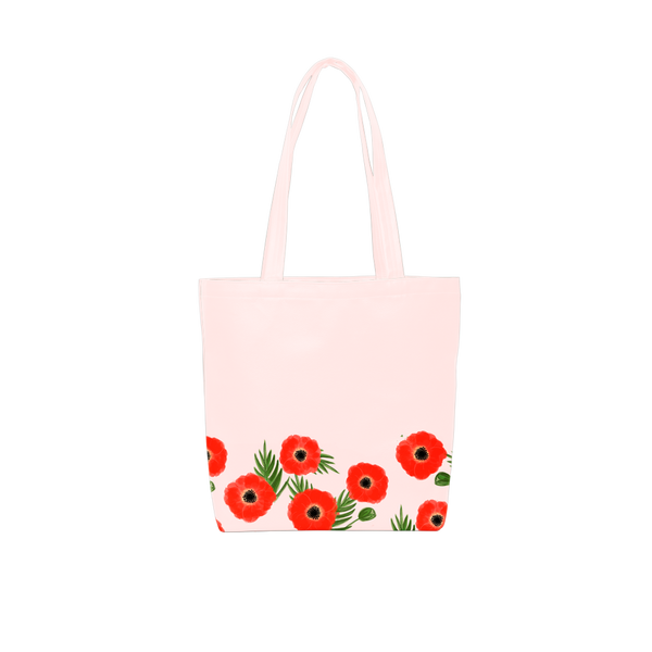 Cute tote bag in blush pink vegan leather with red poppy pattern.