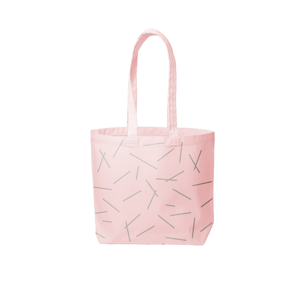 a pink canvas tote bag with pixie stick print