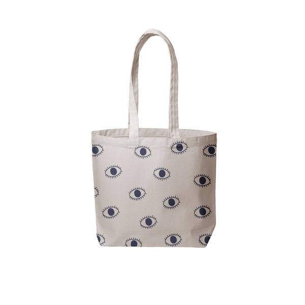 a grey canvas tote bag with blue eyeballs