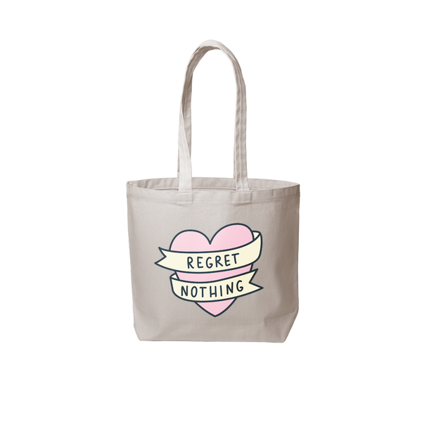 Grey canvas tote bag that has a pink heart and says regret nothing