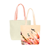 Two cute tote bags; one peach in paradise print and one natural straw with peach canvas straps.