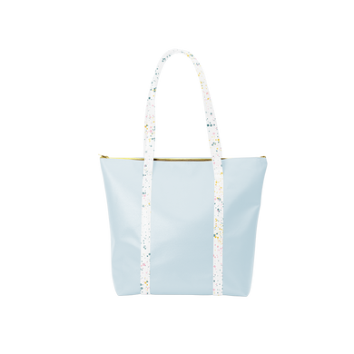 Cute tote bag in light blue vegan leather with white paint splatter straps and zippered top.