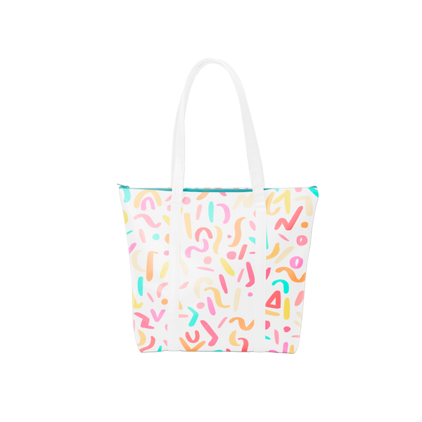 Cute tote bag in white with rainbow confetti print, white straps, and blue zippered top.