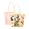 Two cute tote bags with zippered top; lush tropical print and pastel ombre print.