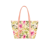 Cute tote bag in tropical floral print, zippered top, and peach shoulder straps.