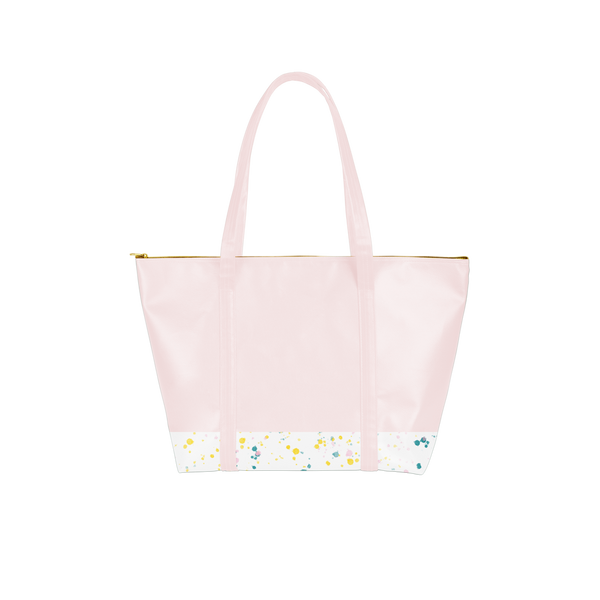 a pink vegan leather bag with splatter on the bottom