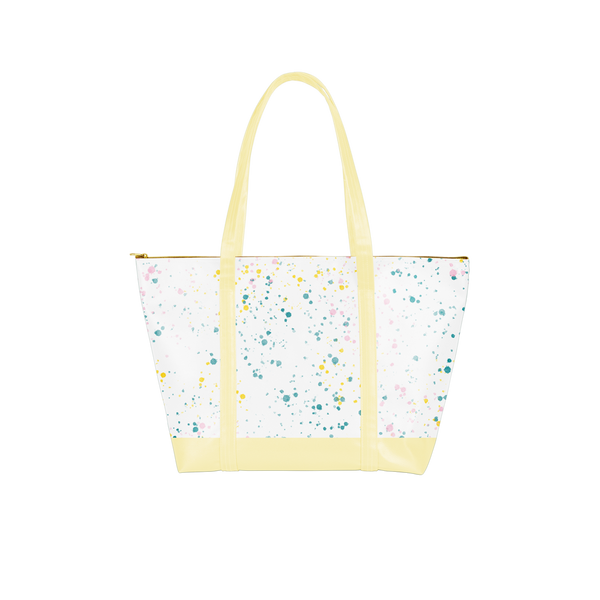 vegan leather weekend bag with white splatter and yellow handles