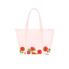 Cute tote bag in blush pink with red poppies, zippered top, and double shoulder strap.