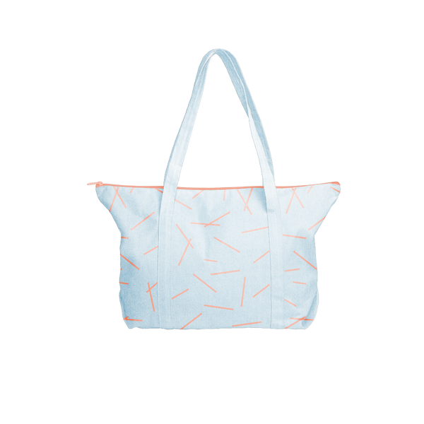 Cute tote bag in beachwash denim canvas with peach zippered top and double shoulder straps.