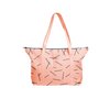 Cute tote bag in peach canvas with navy pixie sticks pattern and navy zipper.