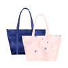 Two cute travel bags; one light purple with abstract florals and the other dark navy blue.