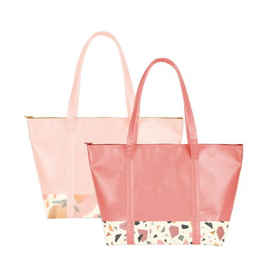 Two cute travel bags; one red with terrazzo trim and one peach with abstract fruit print trim and zippered top.