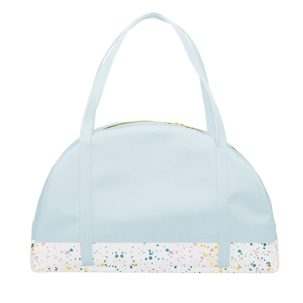 Travel tote bag in powder blue with white paint splatter detail along the bottom and double shoulder straps.