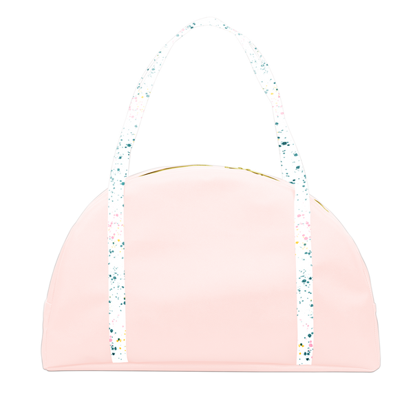 Travel tote bag in blush pint with white paint splatter print double shoulder straps.