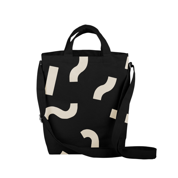 Cute tote bag in black canvas with adjustable shoulder strap and macaroni pattern.