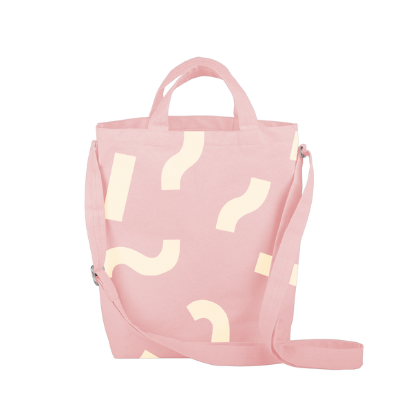 Cute tote bag in blush pink canvas with adjustable shoulder strap and macaroni pattern.