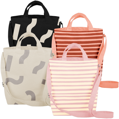Four cute tote bags; pink with yellow stripes, light gray with gray macaroni, peach with red stripes, and black with white macaroni pattern.