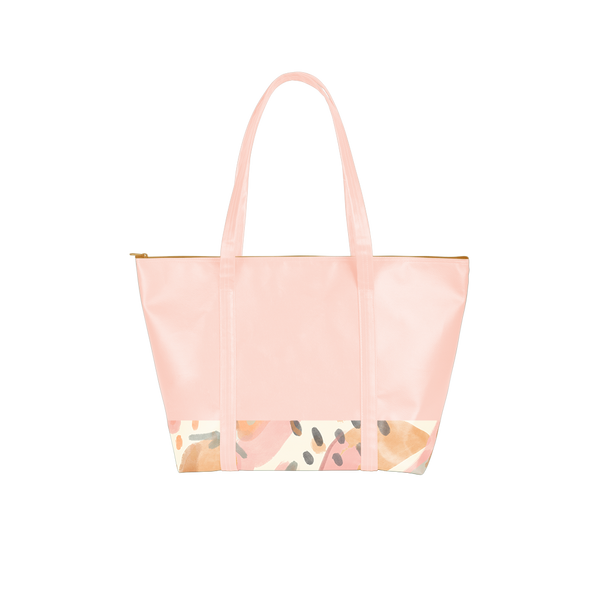 Cute travel bag in peach vegan leather with abstract fruit pattern, zippered top, and double shoulder straps.