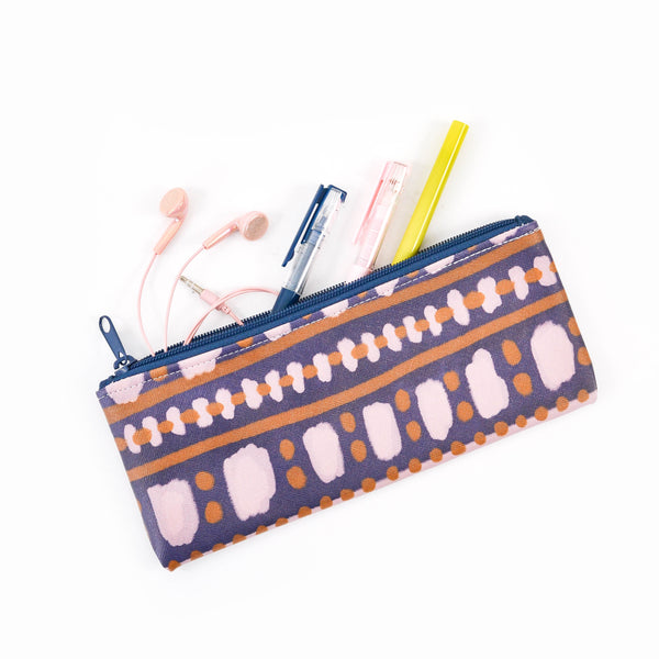 Cute pencil pouch with pens and earbuds spilling out.