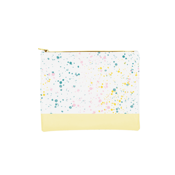 Large makeup pouch in white with paint splatter print and yellow trim along the bottom.