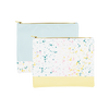 Two large makeup pouches; one white with paint splatter print and a yellow trimmed bottom and the other powder blue with white paint splatter trim along the bottom.