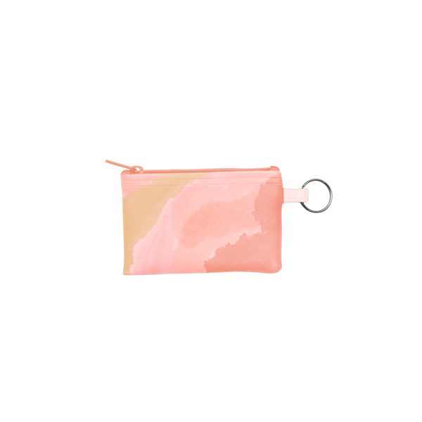 Daydream Penny Key Ring is a coin purse key ring in peach and pink cloud pattern.