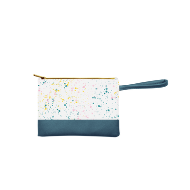 Small pouch wristlet in white with paint splatter print, and a spruce green handle and gold zipper.