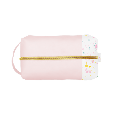 Large toiletries bag with handle and gold zipper in a blush pink with white paint splatter detail.