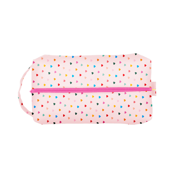 Tiny Hearts Doppelganger is a large travel toiletries case with a carrying handle and rainbow hearts pattern.