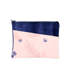 This Dollface Pouch is a large cosmetics pouch with a front pocket in blush pink and navy indigo.