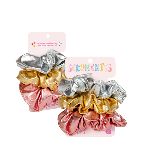 These cute metallic scrunchies come packaged on a colorful cardboard card.
