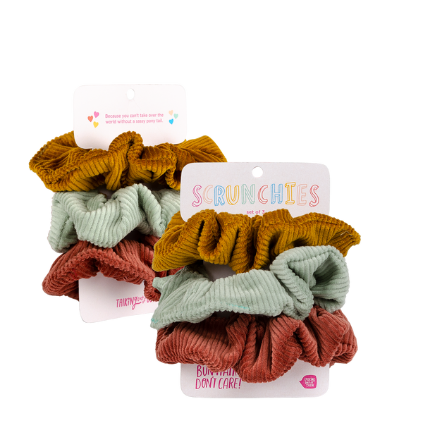 three cute corduroy scrunchies on a backercard
