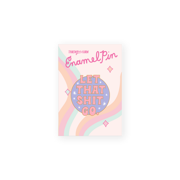 round enamel pin with purple background with saying let that shit go in pink