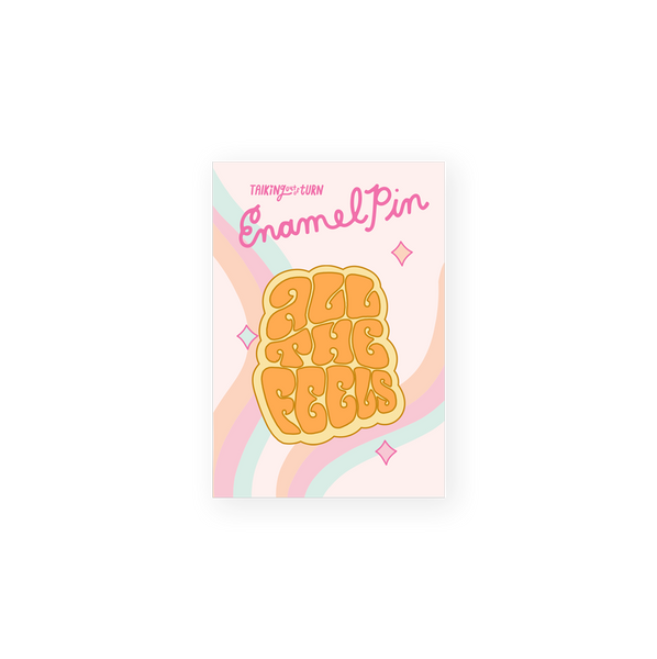 enamel pin saying all the feels in groovy font orange on yellow background