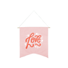 Love Wallflower is a cute canvas wall hanging in blush pink.