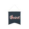 Thrive Wallflower is a cute canvas wall hanging in navy blue with pink lettering.