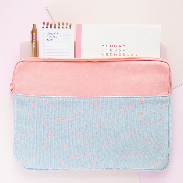 Pixie Sticks Canvas Laptop Sleeve is a cute laptop sleeve in light denim with peach pixie sticks pattern in 13  inch size with a planner. task-pad, and jotter inside