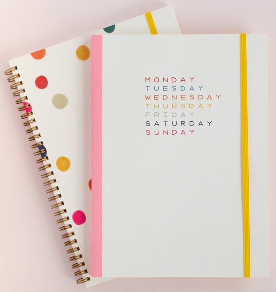 Weekdays planner on top of the ballpit notebook