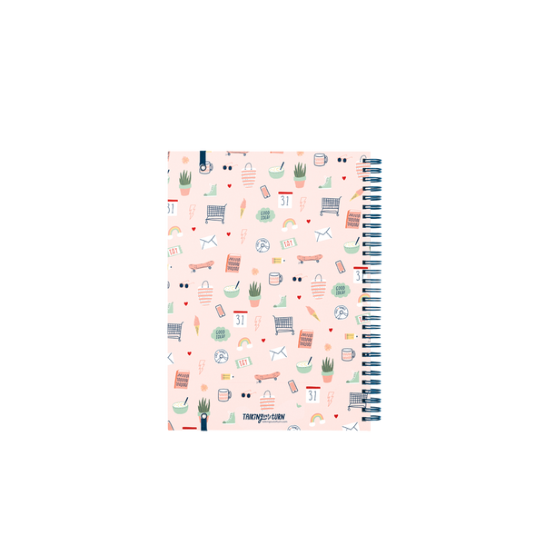 Back cover of a pink planner with a small pattern of cute icons and navy wire laying on a white background. Talking Out of Turn logo written in navy text at the bottom of the planner.